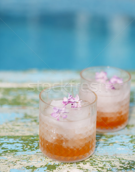 Stock photo: Lilac lemonade water with flowers