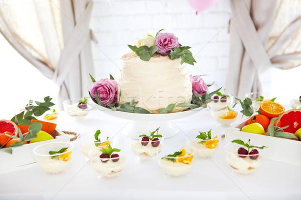 Candy bar with cake, tiramisu, panna cotta and citrus Stock photo © dashapetrenko