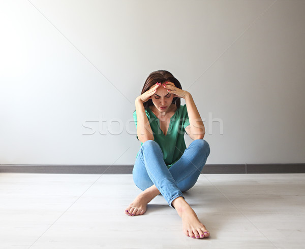 Sad woman looking thoughtful about her troubles in front of a gr Stock photo © dashapetrenko