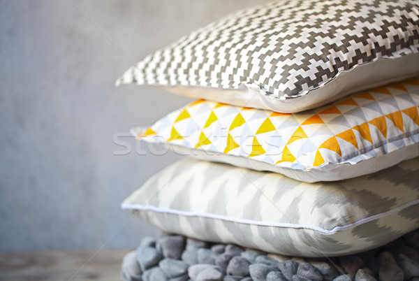 Yellow and grey pillows on the wall background Stock photo © dashapetrenko