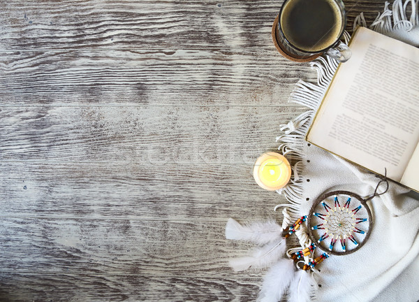 Cup of coffee staying by the book, candle, dream catcher on the  Stock photo © dashapetrenko