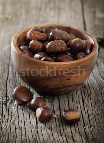 Roasted chestnuts on wooden background Stock photo © dashapetrenko