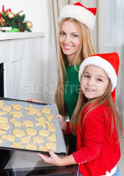 Little girl with her mother baking Christmas cookies Stock photo © dashapetrenko