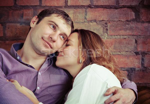 Feliz casal amor sessão sofá mulher Foto stock © dashapetrenko