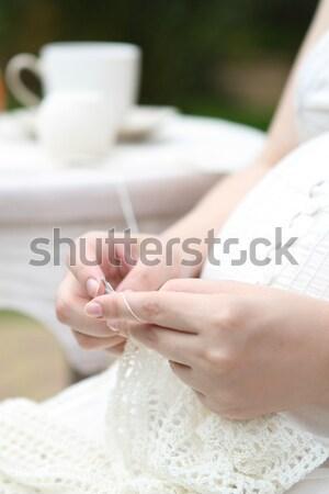 Pregnat woman knitting Stock photo © dashapetrenko