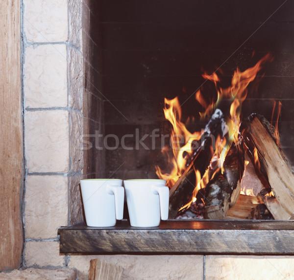Two mugs near the fireplace Stock photo © dashapetrenko