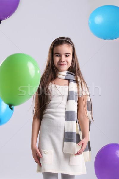 Mały uśmiechnięty dziewczyna balony studio zielone Zdjęcia stock © dashapetrenko
