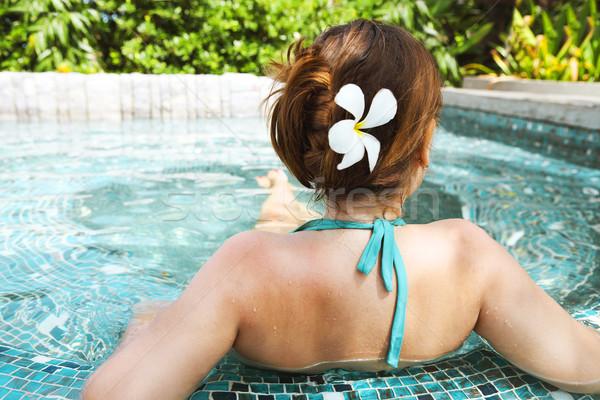 Young beautiful woman relaxing in spa pool Stock photo © dashapetrenko