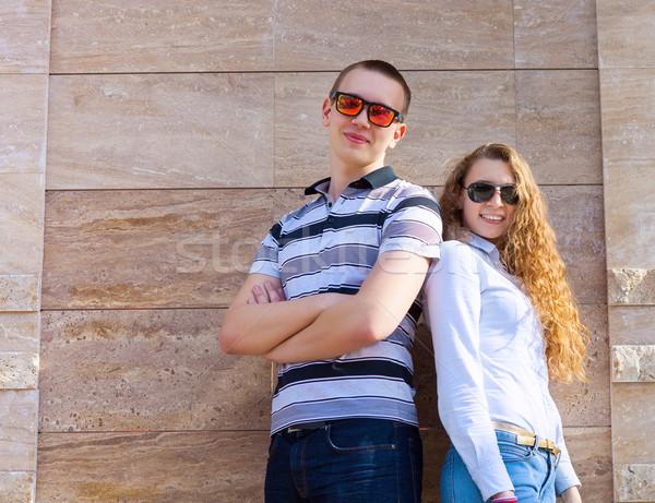 Young couple standing back to back  Stock photo © dashapetrenko