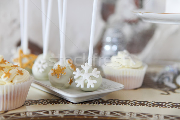 White chocolate Christmas cake pops with snowflakes and cupcakes Stock photo © dashapetrenko
