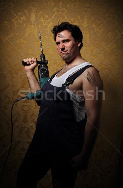 The builder holds the professional puncher-hammer Stock photo © dashapetrenko