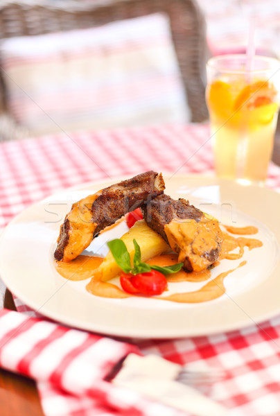 Image of lamb chops on a bed of vegetables Stock photo © dashapetrenko