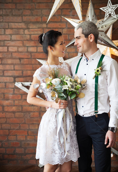 Cheerful married couple near the brick wall  Stock photo © dashapetrenko