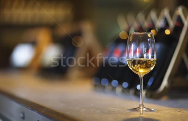 Wine bottles on a wooden shelf. Wine bar.  Stock photo © dashapetrenko
