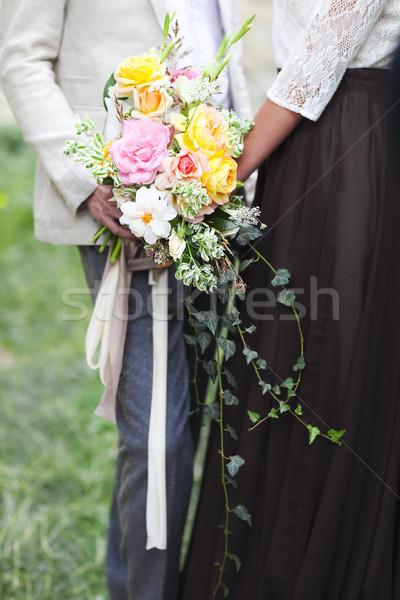 Esküvői ceremónia vőlegény menyasszony virágcsokor közelkép boldog Stock fotó © dashapetrenko