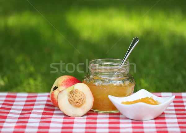 Jarra pêssego congestionamento pêssegos guardanapo comida Foto stock © dashapetrenko