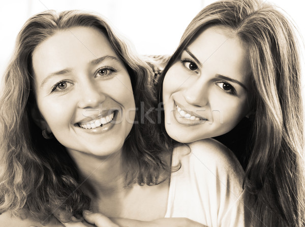 Black and white close up portrait of a mother and teen daughter  Stock photo © dashapetrenko