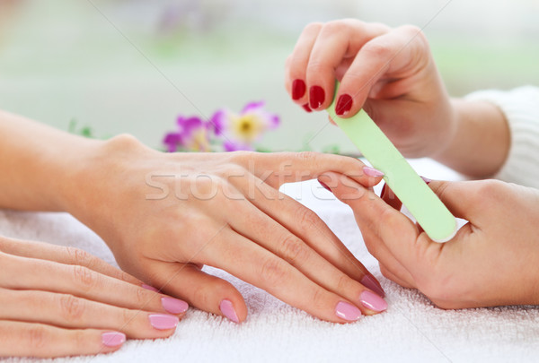 Gentle care of nails in a beauty salon Stock photo © dashapetrenko