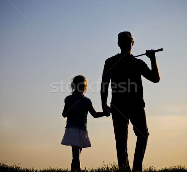 Family of a golfers at sunset Stock photo © dashapetrenko