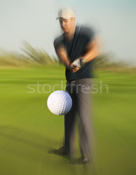 Golf ball just coming off a golfer in swing Stock photo © dashapetrenko