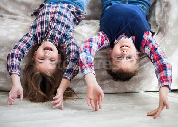 Mutlu çocuklar ters kanepe gülen çocuklar Stok fotoğraf © dashapetrenko