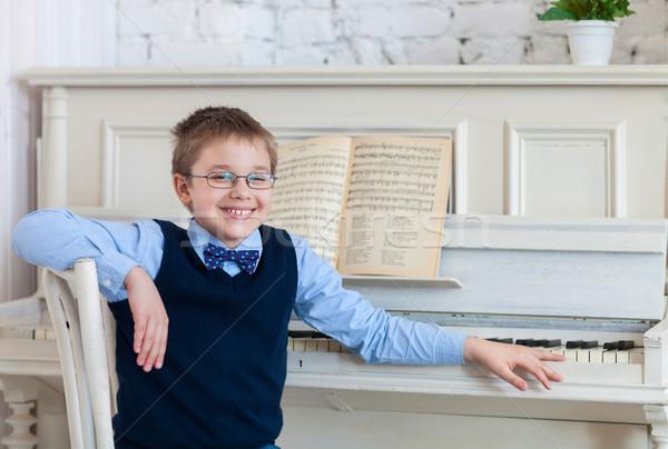 Little boy playing piano at home Stock photo © dashapetrenko