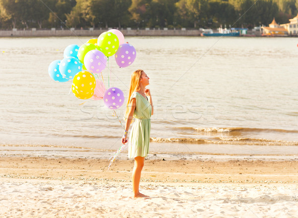 Woman on the beach with colored polka dots balloons Stock photo © dashapetrenko