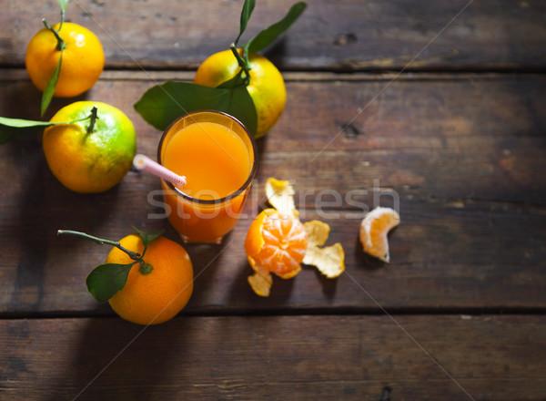 Vidro fresco tangerina suco maduro folhas Foto stock © dashapetrenko