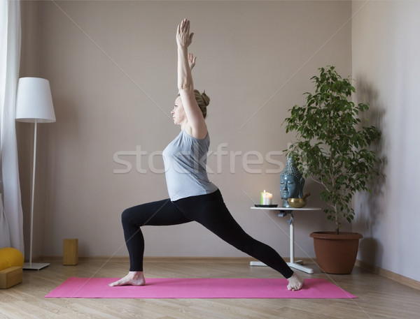 Middle aged woman doing yoga indoors Stock photo © dashapetrenko