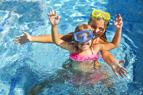 Two funny girls playing in swimming pool Stock photo © dashapetrenko