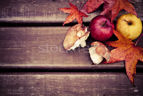 Autumn wooden background with mushrooms and apples Stock photo © dashapetrenko