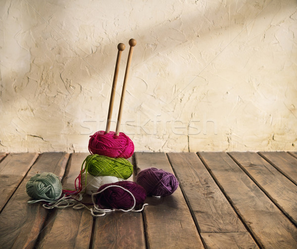 Colorful balls of yarn on a wooden table Stock photo © dashapetrenko