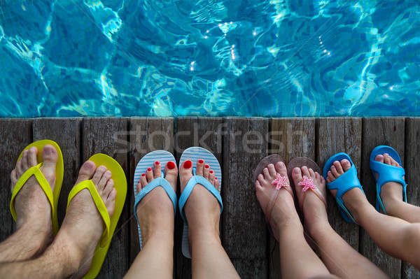 Family wearing brightly colored flip-flops  Stock photo © dashapetrenko