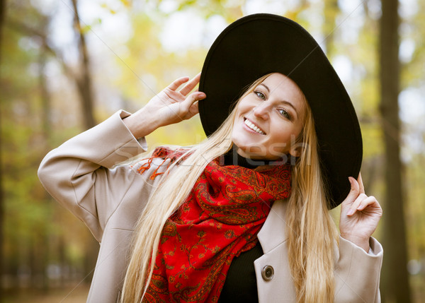 Fashionable blond woman at beautiful autumn alley  Stock photo © dashapetrenko