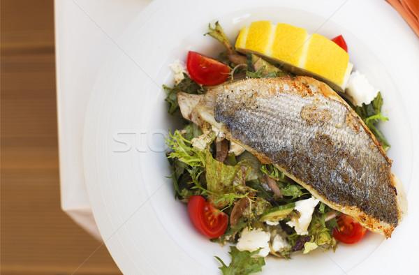 Warm salad with dorado fish on a plate Stock photo © dashapetrenko