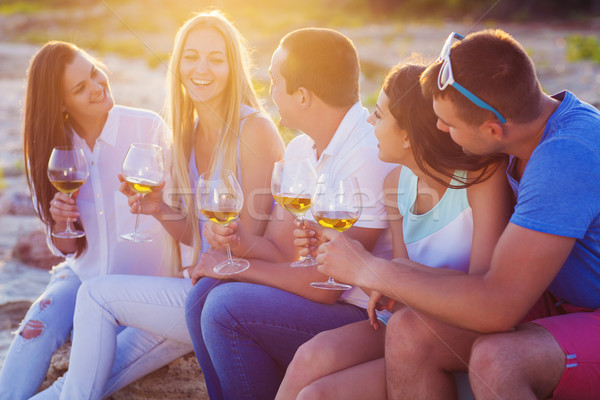 People holding glasses of white wine at the beach picnic Stock photo © dashapetrenko