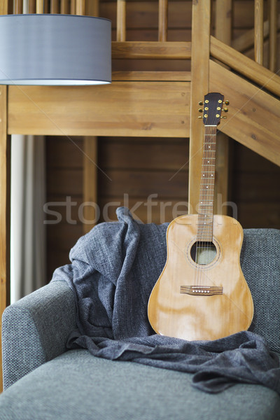 Cozy living room with guitar on the sofa  Stock photo © dashapetrenko