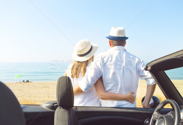 Happy couple near car on the beach Travel and vacation concept Stock photo © dashapetrenko