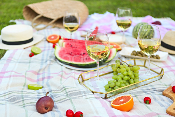 Picnic with white wine on green grass Stock photo © dashapetrenko