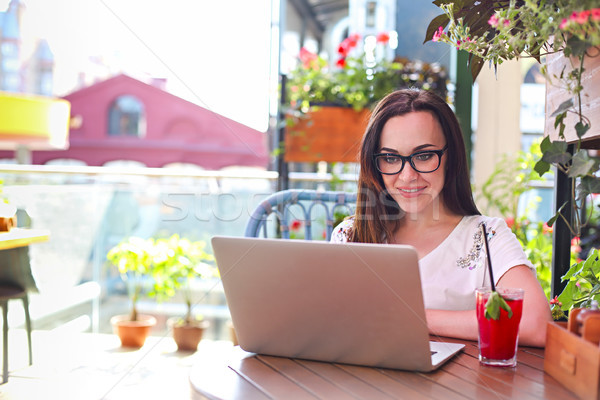Young woman working on computer outdoors Stock photo © dashapetrenko