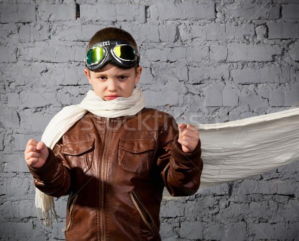 Little boy dreaming of becoming a pilot  Stock photo © dashapetrenko