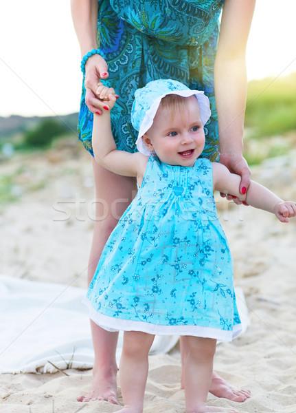 Mother and her baby girl having fun at the beach Stock photo © dashapetrenko