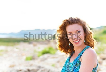 Portrait of the beautiful young woman with fluttering red hair Stock photo © dashapetrenko