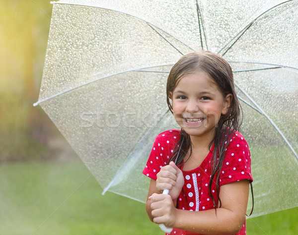 Child with wearing polka dots dress under umbrella Stock photo © dashapetrenko
