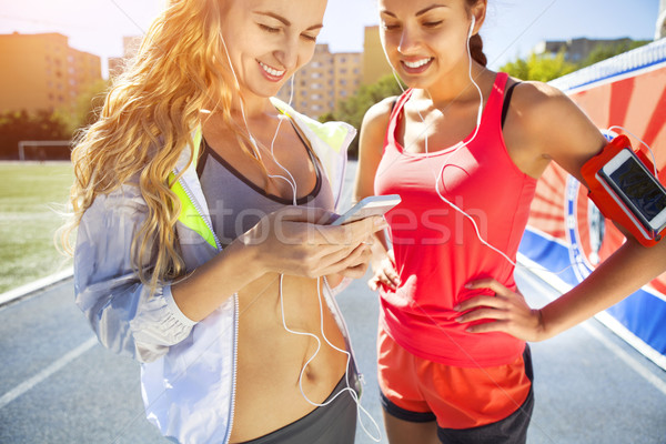 Stock photo: Runners on the stadium track. Women summer fitness workout