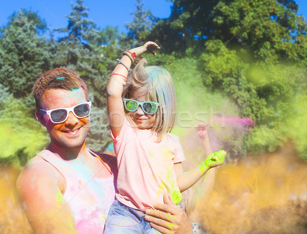 Happy young father with daughter on holi color festival Stock photo © dashapetrenko