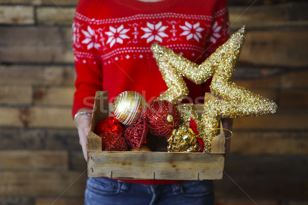 A woman holds a box with a lot of Christmas decorations Stock photo © dashapetrenko