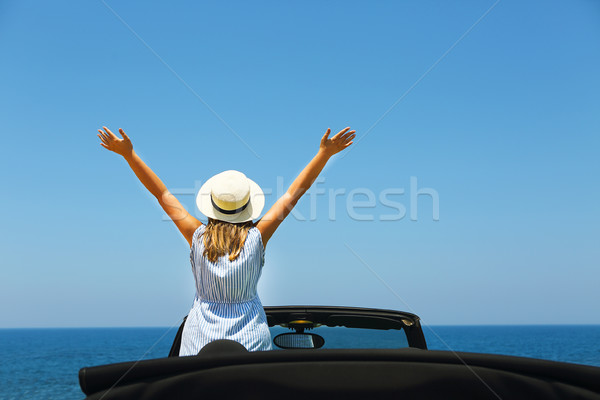 Happy young woman in car on the beach Stock photo © dashapetrenko