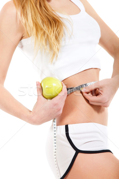 Woman holding apple and measuring her waist  Stock photo © dashapetrenko