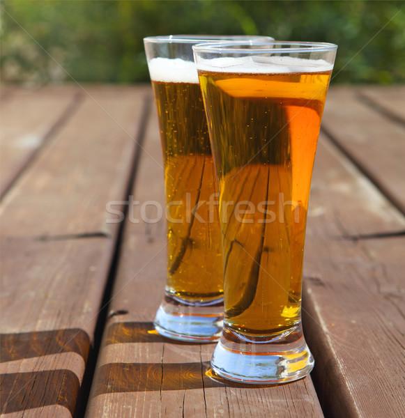 Kettő szemüveg világos sör asztal kint nyáridő Stock fotó © dashapetrenko